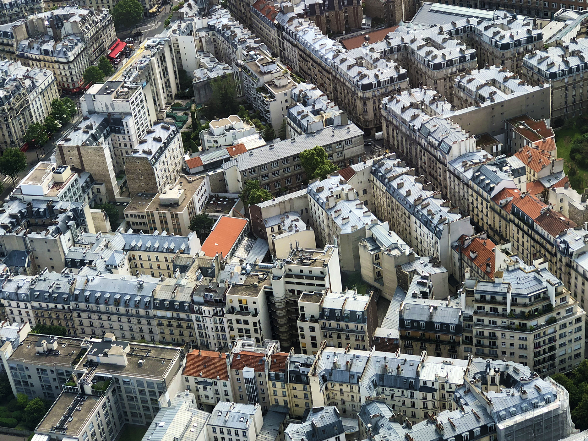 Rooftops from the 56th floor. La Rotonde restaurant (red awning) at top left.