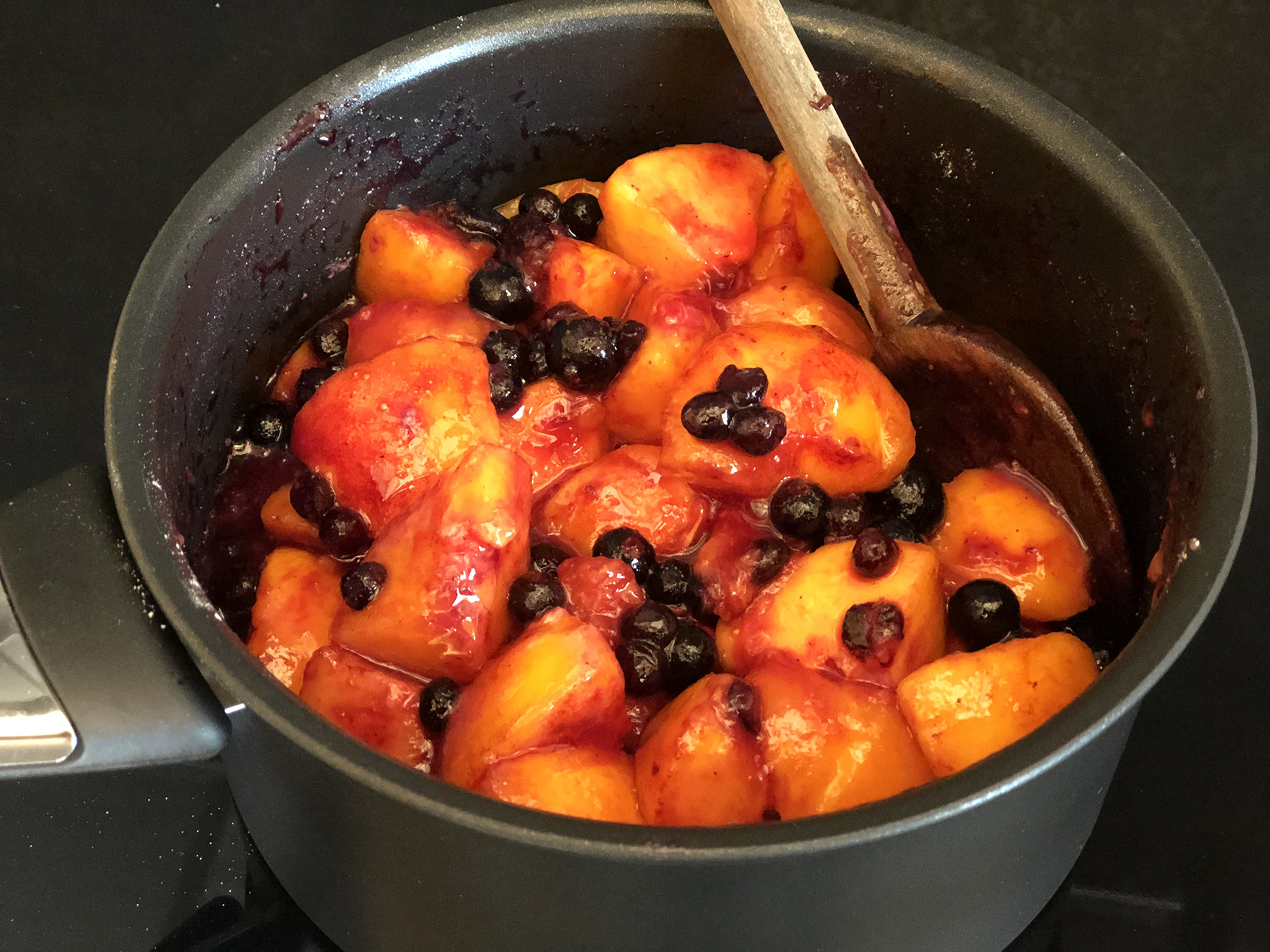 Simmering peaches and blackcurrant