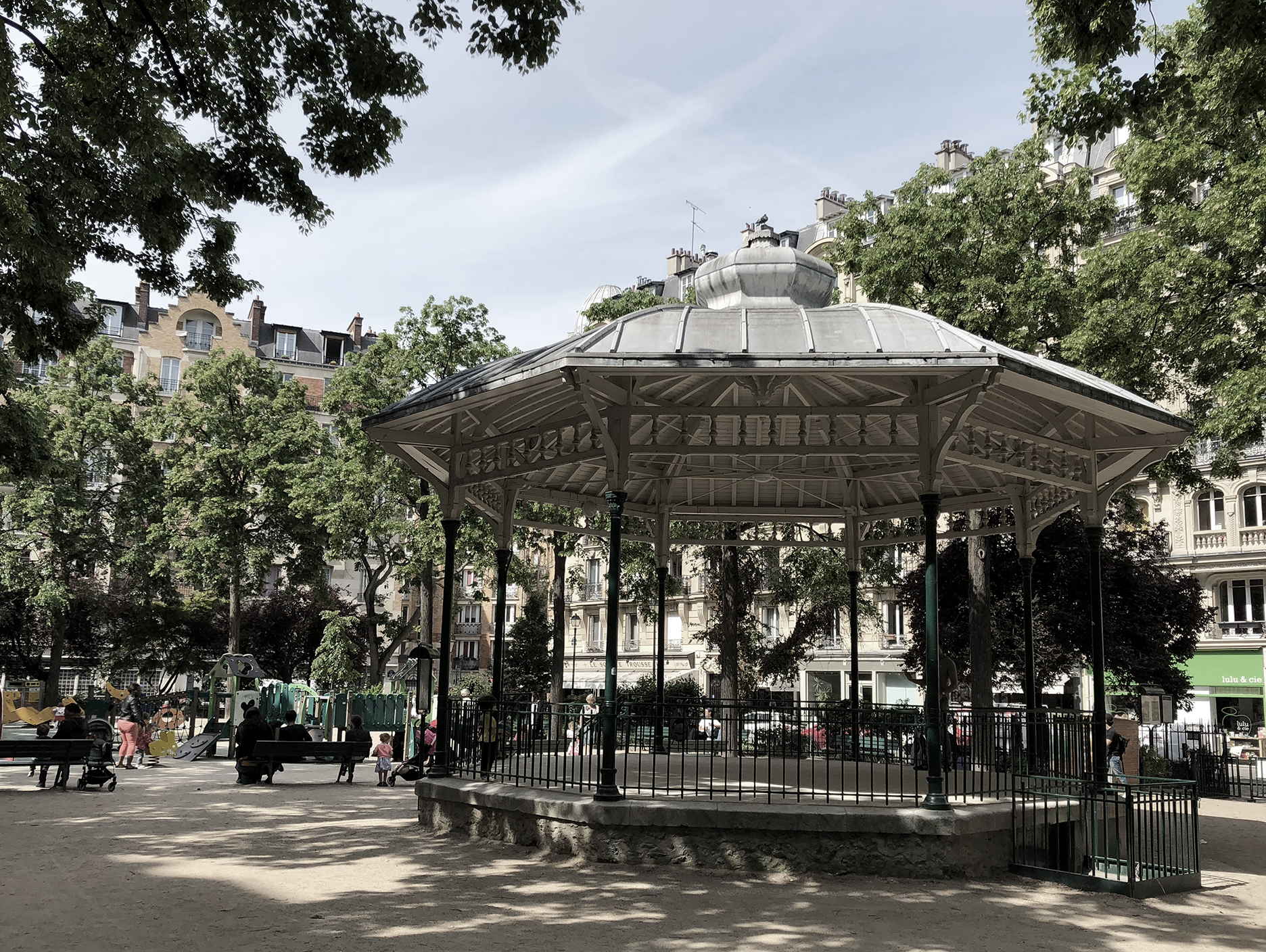 Square Trousseau just off the busy street. Haussmannian buildings on the other three sides. Classic music kiosk and playground for children. A locals' favorite.