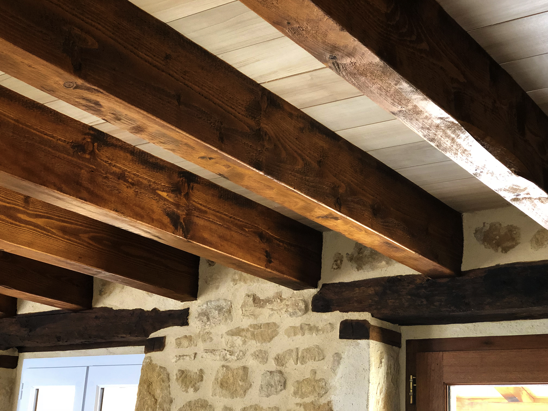 Stained beams in the living room