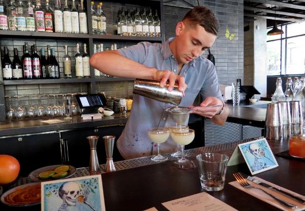 Bartender Robin Miller pouring a drink at Espita Mezcaleria on 9th Street in Washington, DC.
