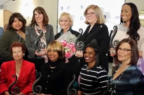 Anne Mervenne receiving award in Michigan with other women professionals