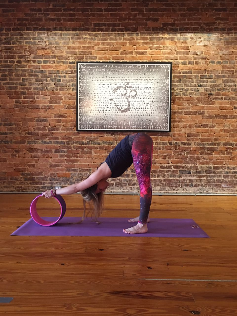 Andrea teaching Yoga Wheel.