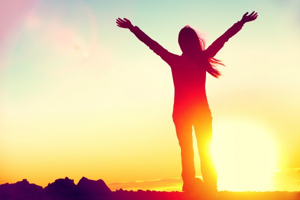 Bigstock_ 99936598 - Happy celebrating winning success woman at sunset or sunrise standing elated with arms raised up abo-2.jpg