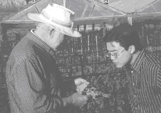 "Everett J. ""Deke"" Dietrick,  Entomologist with trainee."