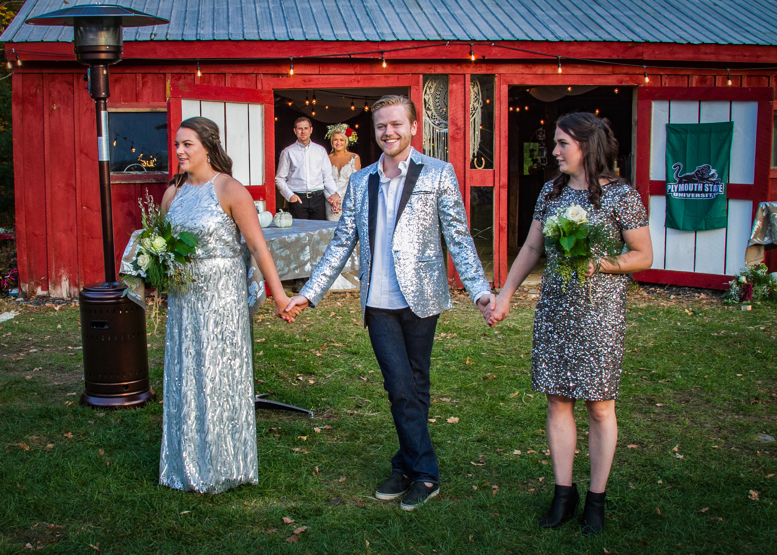 This lovely occasion is being held in front of our barn.  The fun, sparkly dresses and coat are a wise choice for the evening's attire.  To help keep guests warm is this tower heater to the left.  Note how cute Lexee and Brandon are in the back.