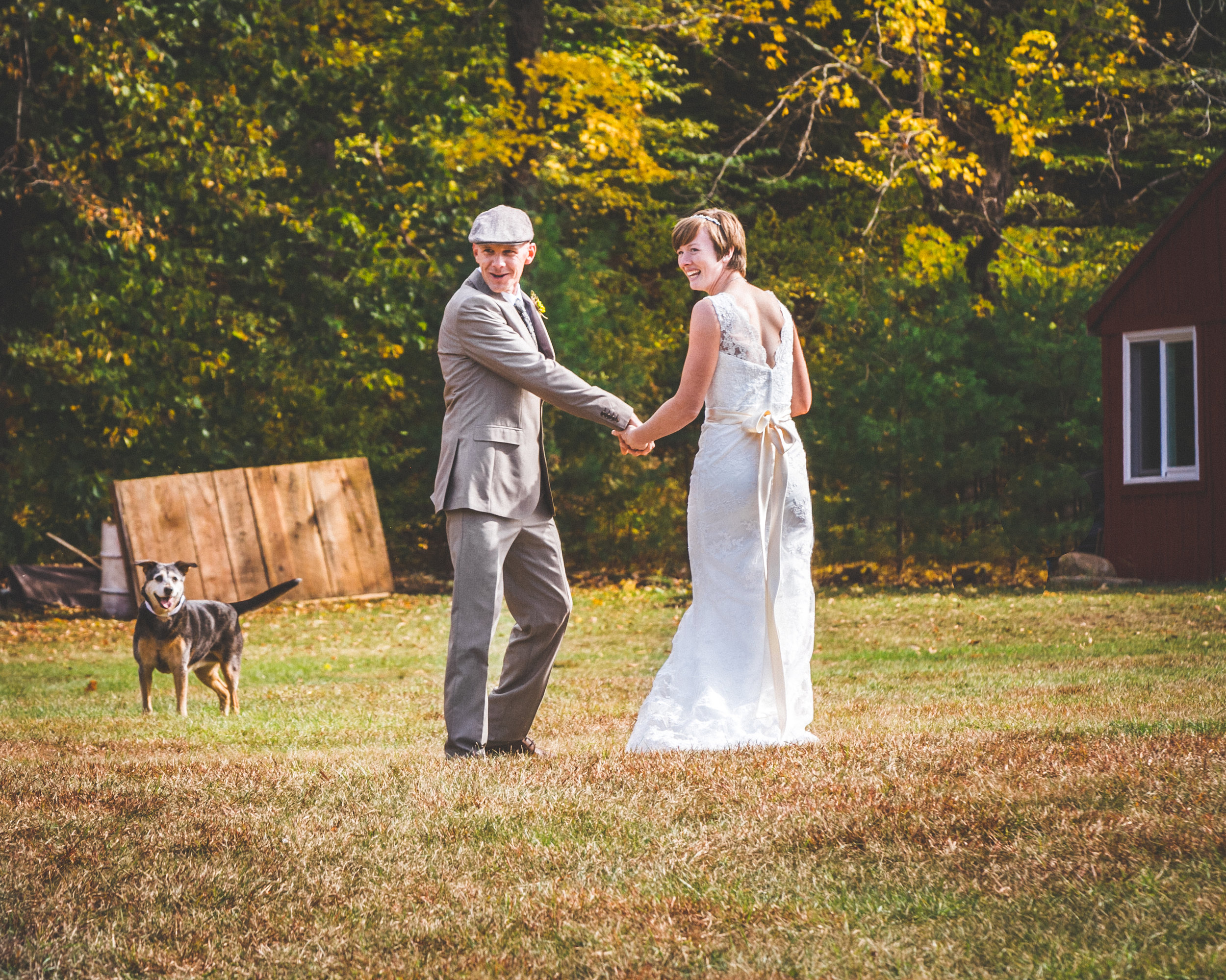 This adorable couple is Elisa and Scott.  Elissa has a lace fit and flare with a light ribbon.  Scott has a gray suit which he chose to accessorize with a pageboy hat.  This couple chose to have their dog as part of their big day.