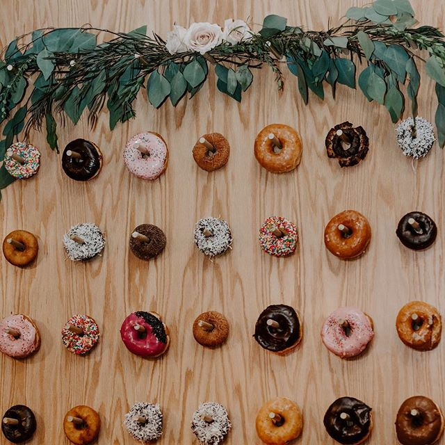 Who doesn't love donuts?! This donut wall is something we offer for rental to our lovely couples! It's huge, it holds over 50 donuts and you can add your own decor to it to make in unique! Because it is about 7ft tall, it can add as its own decor that you don't have to bring or buy! If you're not a fan of wedding cake, donuts are a wonderful option!