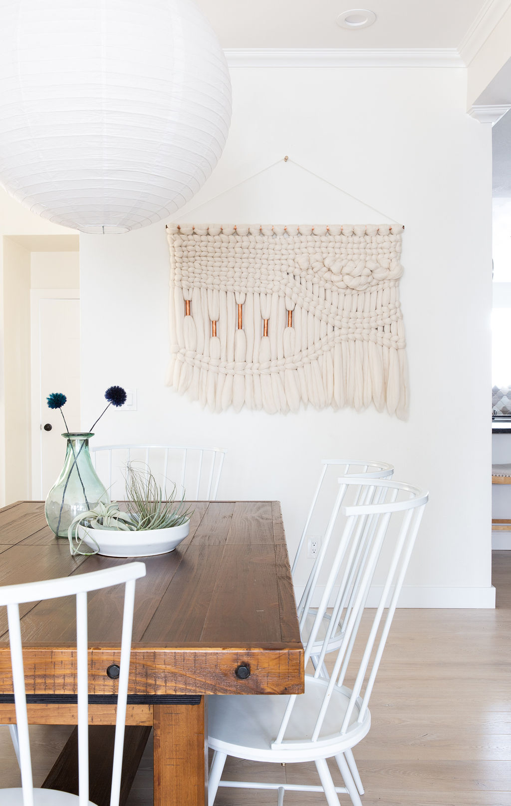Love & Interiors_Cozy_ San Francisco_Dining Room_Farmhouse Table_Paper Pendant Light_Woven Wall Hanging_Air Plant.jpg