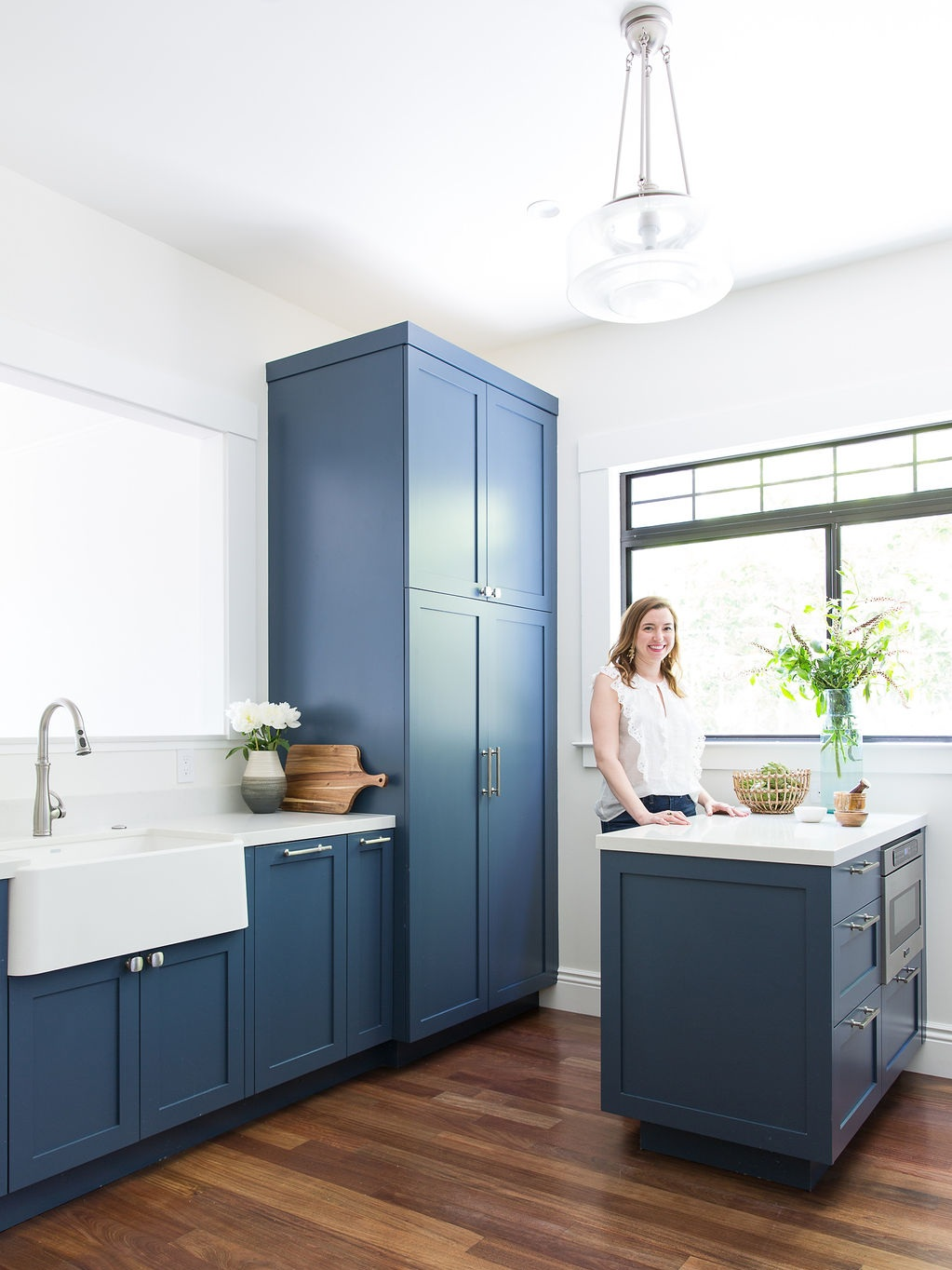 Love-%26-Interiors-San-Francisco-Pacific-Heights-Transitional-Blue-Kitchen-Built-in-Pantry-and-White-Farmhouse-Sink-With-Pendant-Light-And-Interior-Designer.jpg