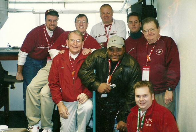 Photo courtesy of Michael Dean, taken at the 2002 Cotton Bowl. From left-to-right starting at the top, Jeff Couch, Michael Dean, Terry McLemore, Ron Benton, Bob Barry, Sr., Keith Jackson, Merv Johnson, and author Jake Fisher.