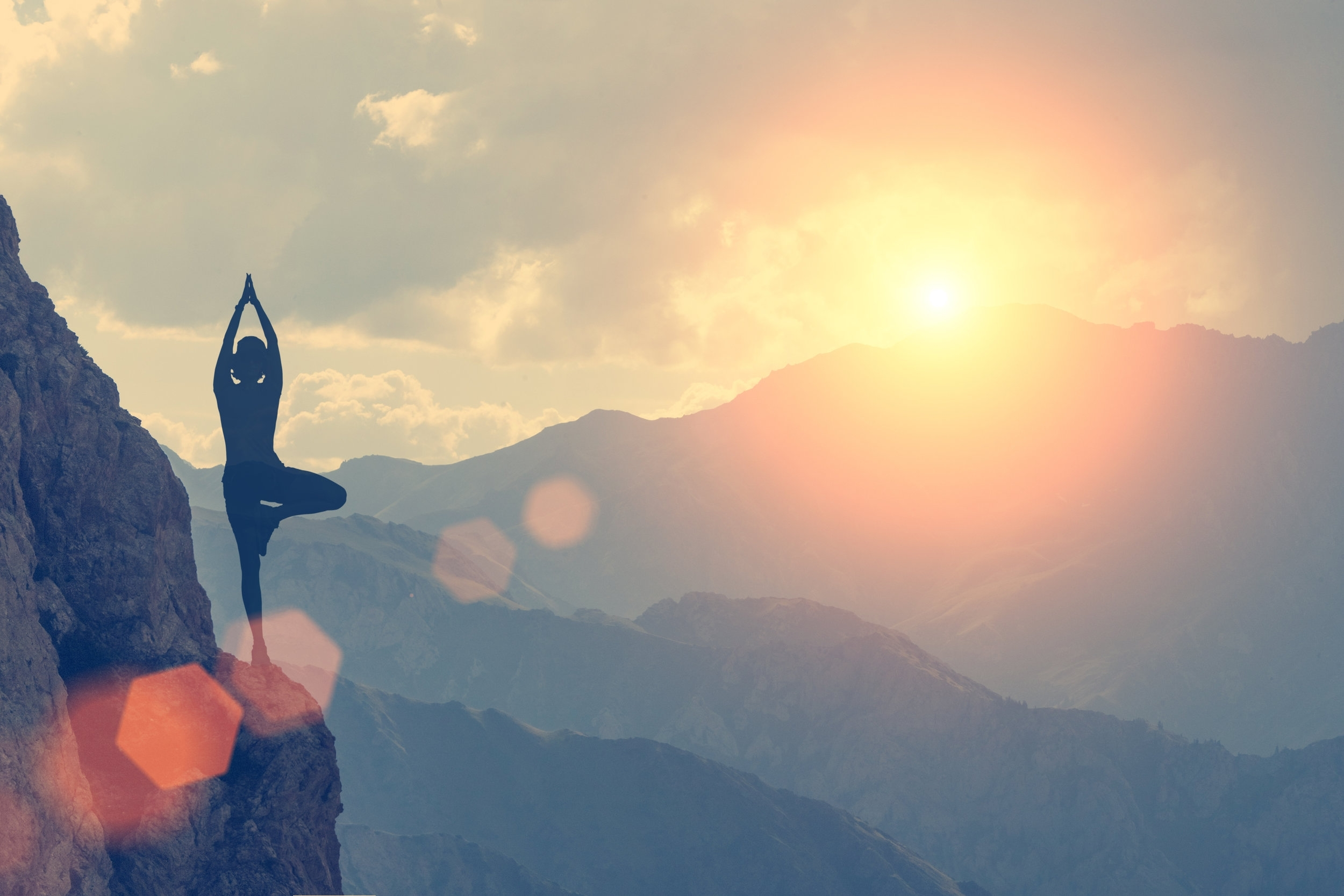 stock-photo-a-woman-practices-yoga-on-a-background-of-mountains-and-sky-toned-412255600.jpg
