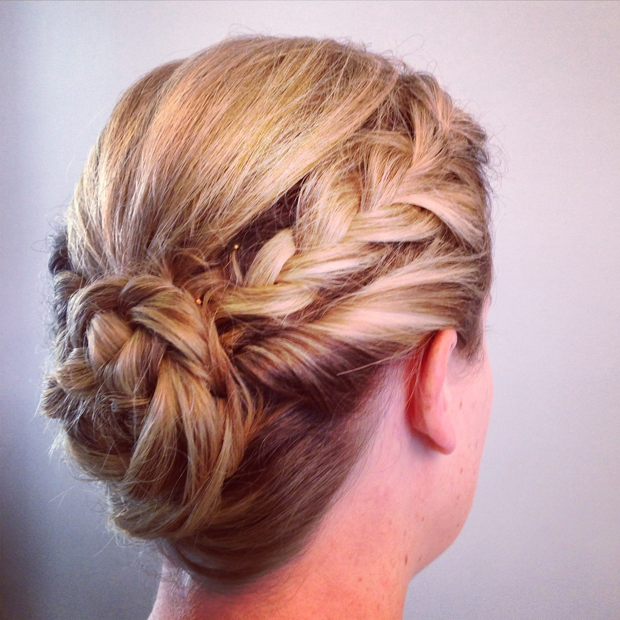 - Elegant Updo -a timeless look for special occasions.