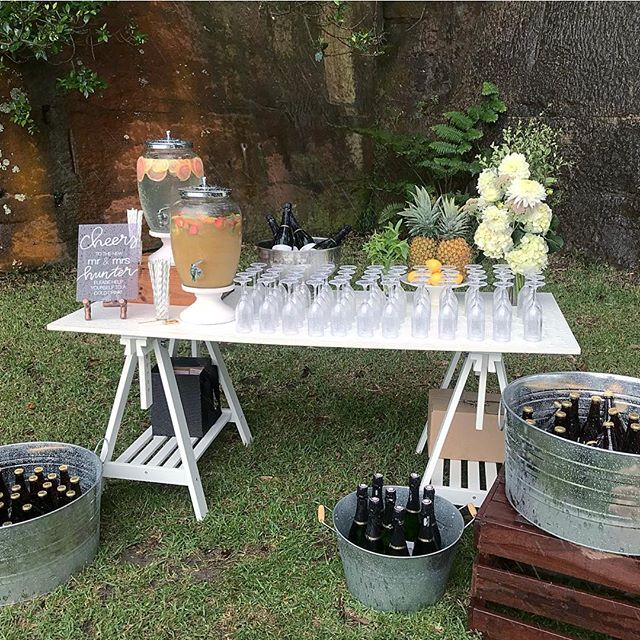 Drink station at the ready! 🥂⁣⠀ Despite getting completely washed out, I was stocked to create this for the lovely Jaclyn + Campbell 💕What a day! 🌧🌧⁣⠀ .⁣⠀ 🍻 🥂🍹Our dreamy drink station packages come with: ⁣⠀ 2 x drink dispensers filled with infused water and fruit mocktail ⁣⠀ Paper straws and cups selected to match your theme ⁣⠀ Up to 70 champagne glasses ⁣⠀ Ice and champagne buckets for your beverages ⁣⠀ Miscellaneous crates, props, styling details and a whole lotta love 💖⁣⠀ .⁣⠀ #bradleysheadampitheatre⁣⠀ Styling @stylepopevents⁣⠀ Florals @clementineandrose⁣⠀ Find out more at www.stylepopevents.com ⁣⠀ .⁣⠀ .⁣⠀ .⁣⠀ .⁣⠀ .⁣⠀ .⁣⠀ .⁣⠀ .⁣⠀ #drinkstation #happyhour #weddingdecor #womenwithambition #communityovercompetition #girltribe #womenwhowork #thefutureisfemale #hustlehard #femaleentrepreneur #womeninbiz #shesaidyes #ido #instawedding #bridetobe #weddinginspo #weddinginspiration#weddingideas #weddingstyle#weddingdetails #weddingplanning #weddingstylist #sydneyweddingstylist #weddingceremony #minimalwedding #sydneywedding  #weddingceremony #weddingceremonystyling ⁣⠀