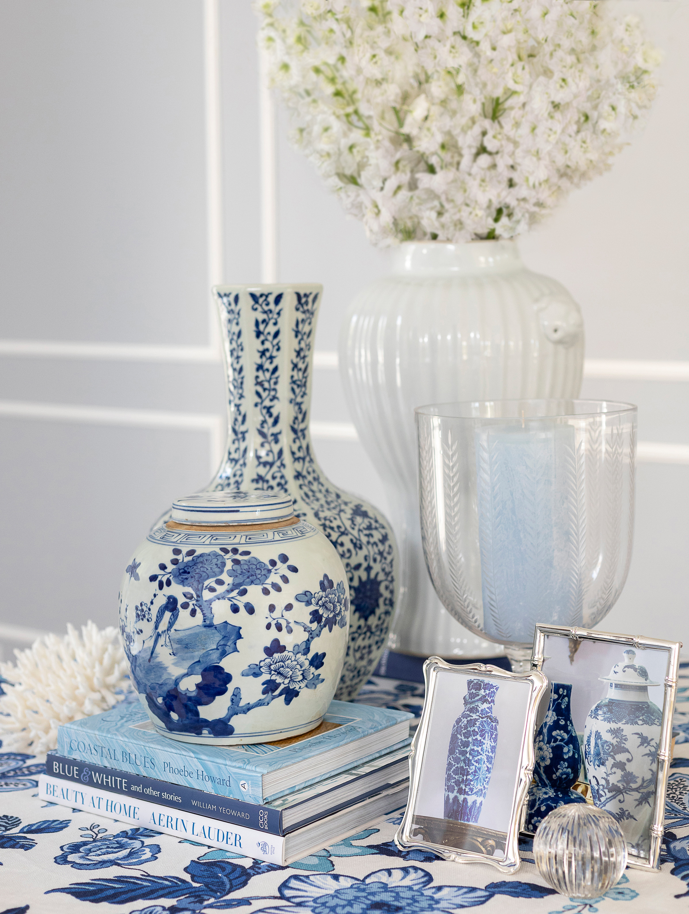 A classic skirted table styled with blue and white ginger jars gives an elegant feel to the room -