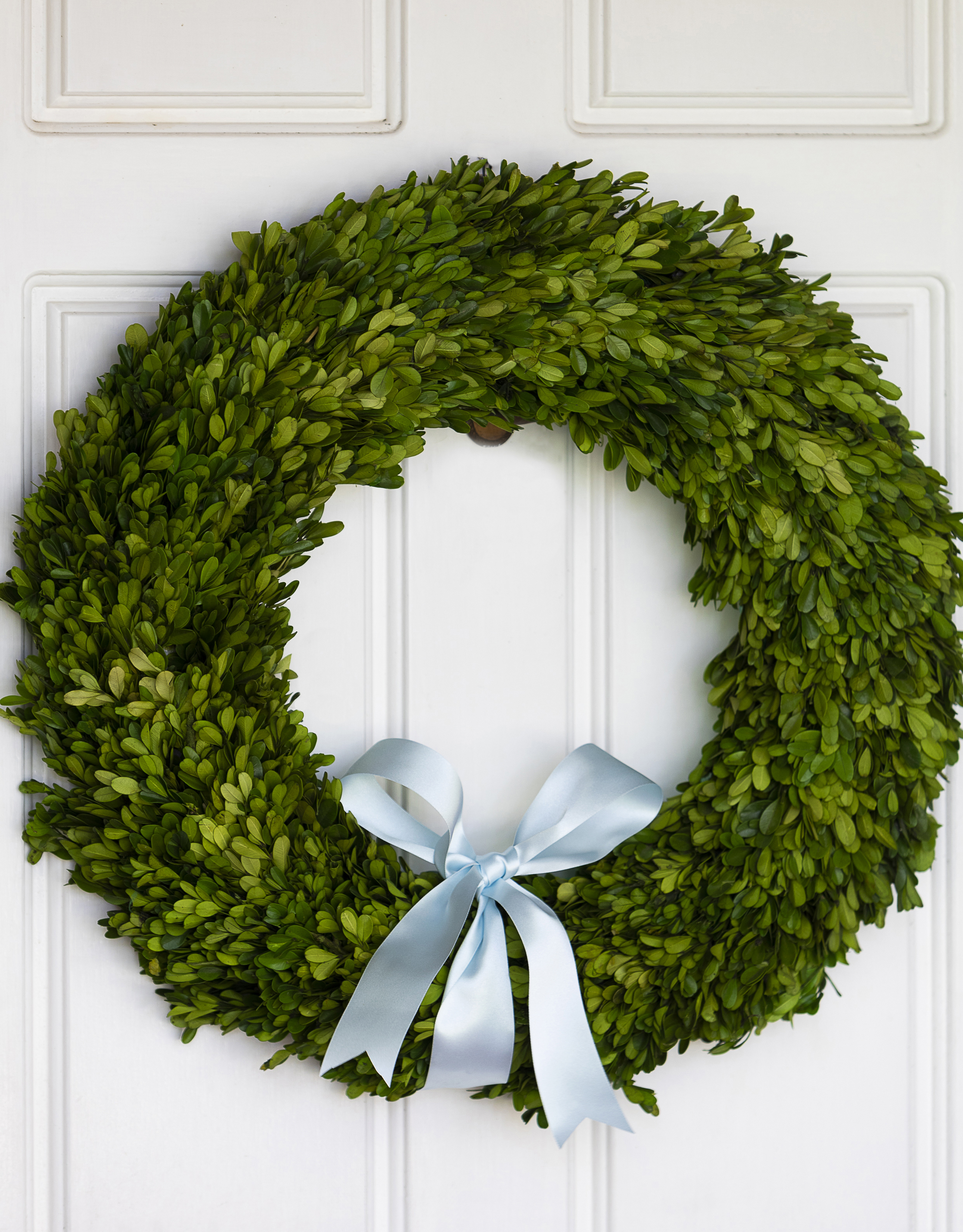 deck the doorS with beautiful boxwood wreaths -