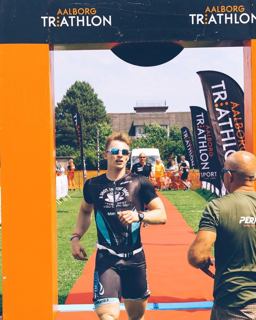 Andres crosses the finish line of the 1/4 Ironman