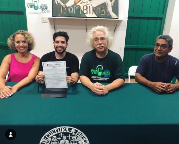 Official Contract Signing. Dr. Lori Ramos (left), Sebastian Escobar, Rob Rabin, Armando Torres