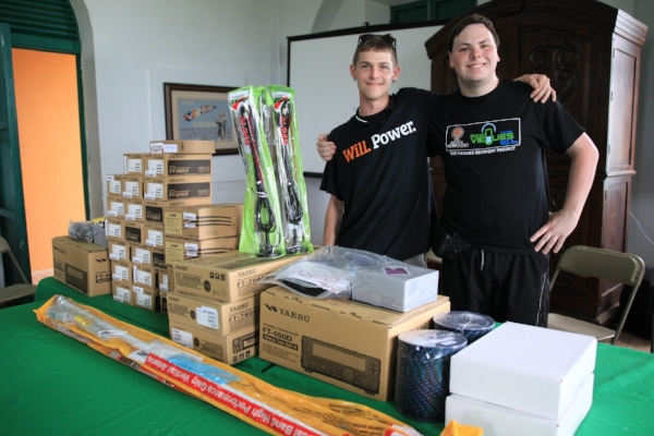 Matt Mullins (left) with Tiernan Doyle (right) with boxes of supplies for HAM Radio