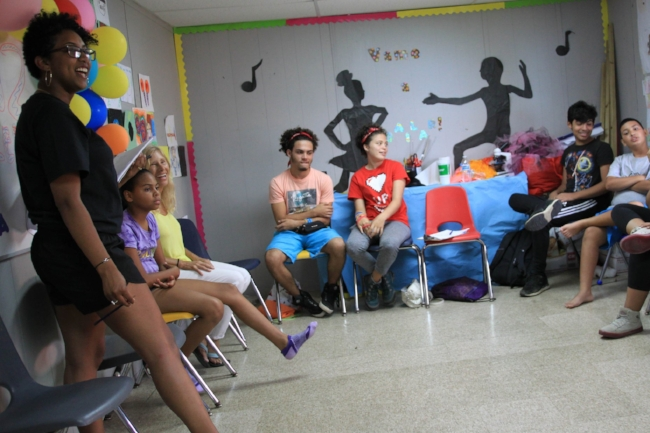 Lara addressing her students at the Boys & Girls Club in Vieques