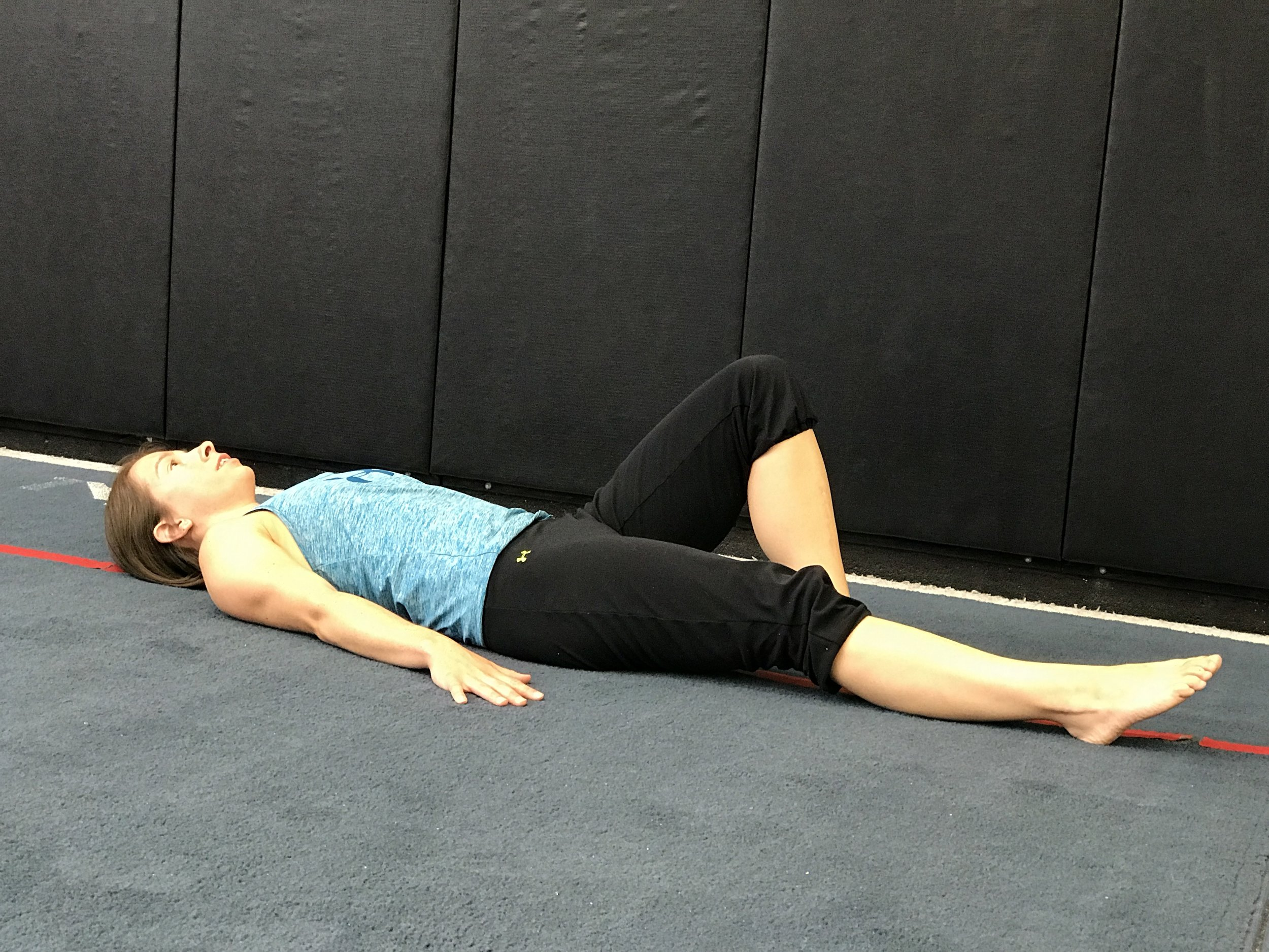 Starting position: Laying with the knees bent and feet flat.  Hands on the floor next to you for support/balance. Extend one leg (straighten that knee). Tighten the core (think abdominal brace/kegel).