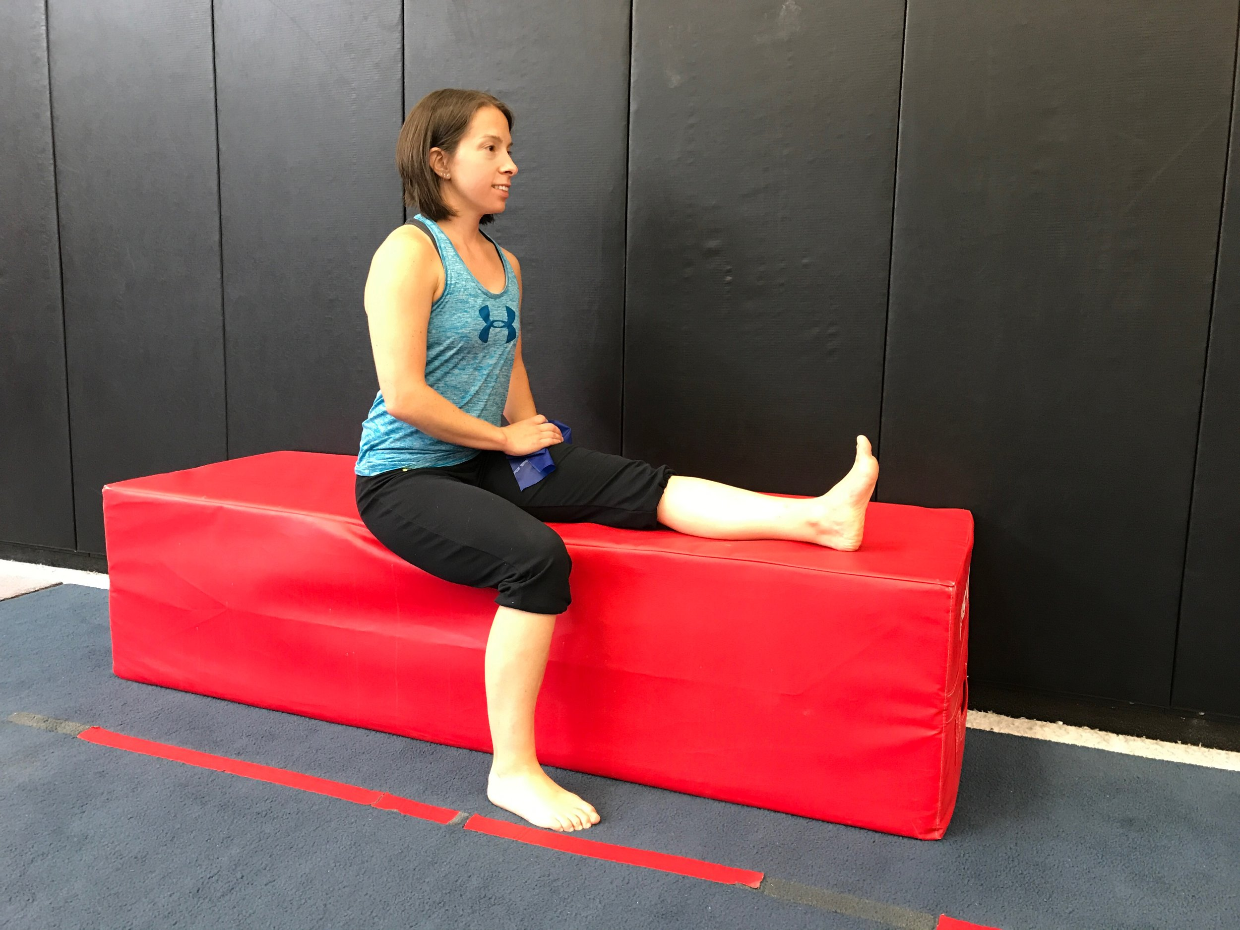 Starting position: On the edge of a table/bed with the targeted leg straight. Back straight & toe up on that side.