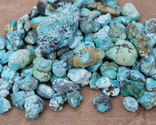 1lb of Natural Blue Moon Turquoise Rough Nuggets purchased directly from the miner. This turquoise is photographed dry, but it still demonstrates the beautiful light blues, soft greens and dark blues that the mine is capable of producing.