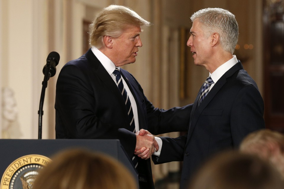 President Trump Shakes Hands with Supreme Court Justice Neil Gorsuch. Kevin Lamarque / Reuters