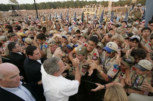 George W. Bush is greeted by tens of thousands of scouts in 2005 during the Boy Scout National Jamboree. Breaking a long-standing tradition of presidential visits, former President Obama skipped the event.