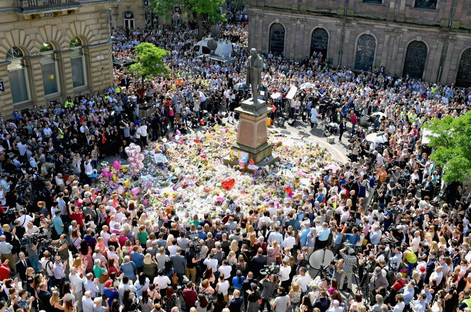 Mourners gather at St. Ann's Square in Manchester