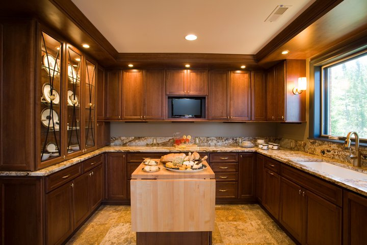 Our interior house painting services include applying new colors and finishes to kitchen cabinetry.