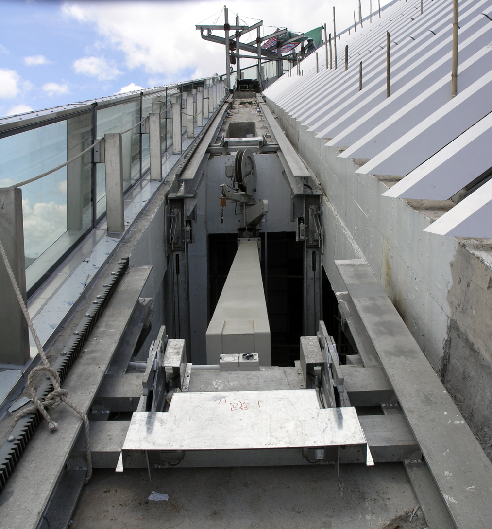 Above:The 2 climbing machines utilize a scissor lift to lower and hide them when not in operation.