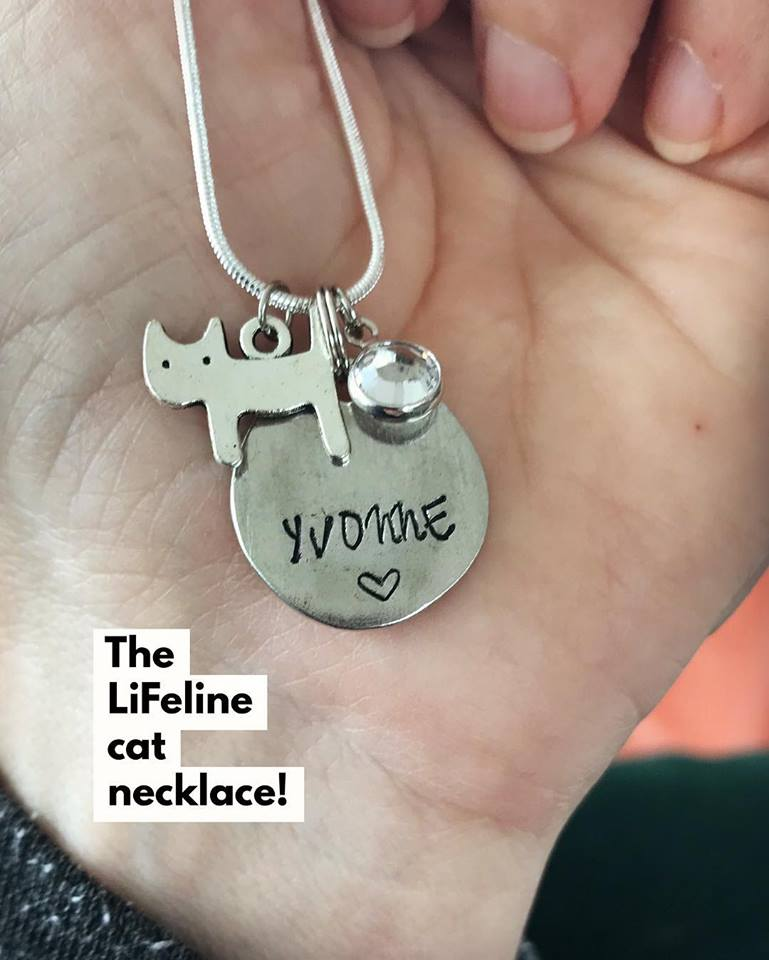 """Personalized Necklace - 250 kr - This adorable, limited edition necklace is 46cm (18"""") with a genuine silver-plated chain, hand-stamped with your name, a Swarovski crystal and a silver cat charm to show your love of cats. The price is 250 kroner, and will be made and mailed within one week of your order. Each necklace supports one of our shelter cats for two weeks. To order, please comment or direct message us on Facebook or Instagram with the name you would like stamped on the necklace. Once we confirm your order we will invite you to pay on Swish or Bank Giro. Due to space, we can only fit names up to 7 characters."""