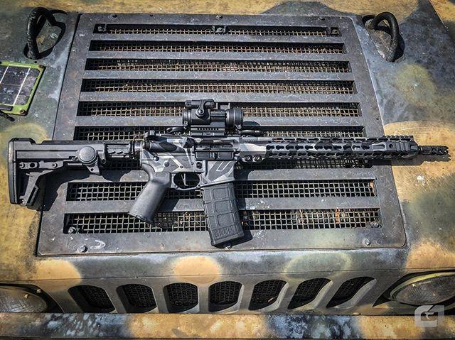 That @tridentweaponry low recoil AR platform is 👌  #lineone #filmmakersthatshoot #pewpew #thepewpewlife #tacticalphotography #cerakote #humvee #deepwoodsusa #556 #223 #patrolrifle  @aimpointusa patrol optic