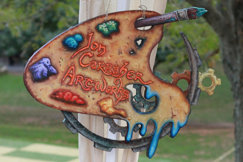 jon-carraher-artworks-sign-at-fantasy-artist-booth-at-outdoor-festival-2017.jpg
