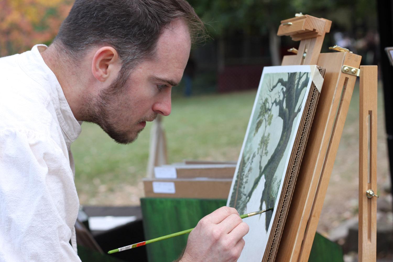 jon-carraher-fantasy-artist-working-at-his-easel-at-outdoor-festival-IMG_1935.jpg