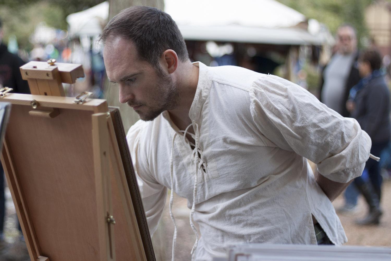 jon-carraher-fantasy-artist-working-at-his-easel-at-outdoor-festival-IMG_1956.jpg