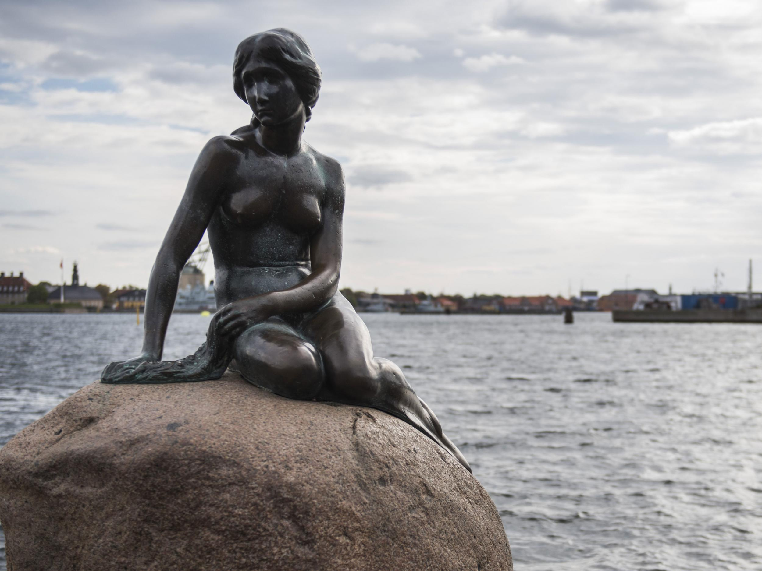 The Little Mermaid guards the port to Nyhavn. One of the most visited attractions in Copenhagen. A must on our walking tour.