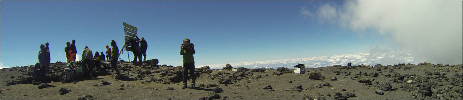 I'm standing on the summit of Mount Kilimanjaro, and taking a photo of my husband. I discovered this treasure a year after our trip, on his GoPro.