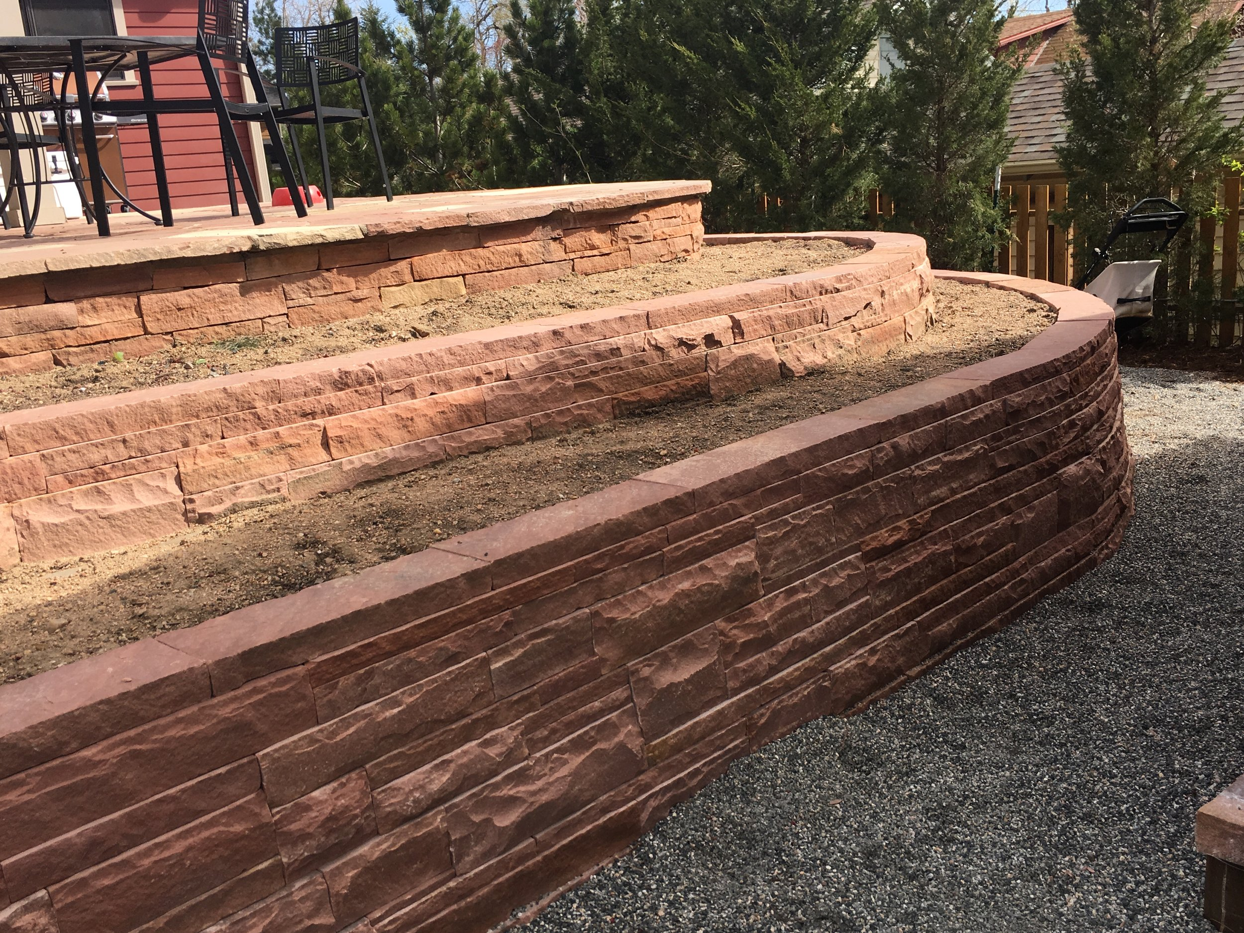 landscape retaining wall | dry stack stone wall | retaining wall materials