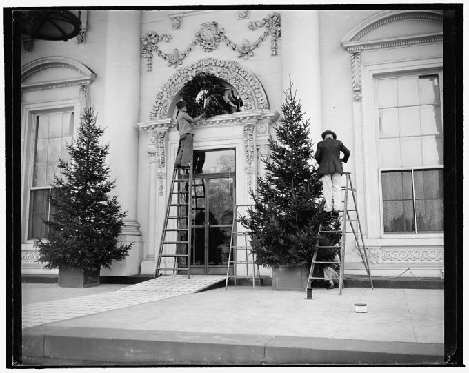 Workman decorate the front of White House, December 19, 1939. Library of Congress, Prints and Photographs Division.