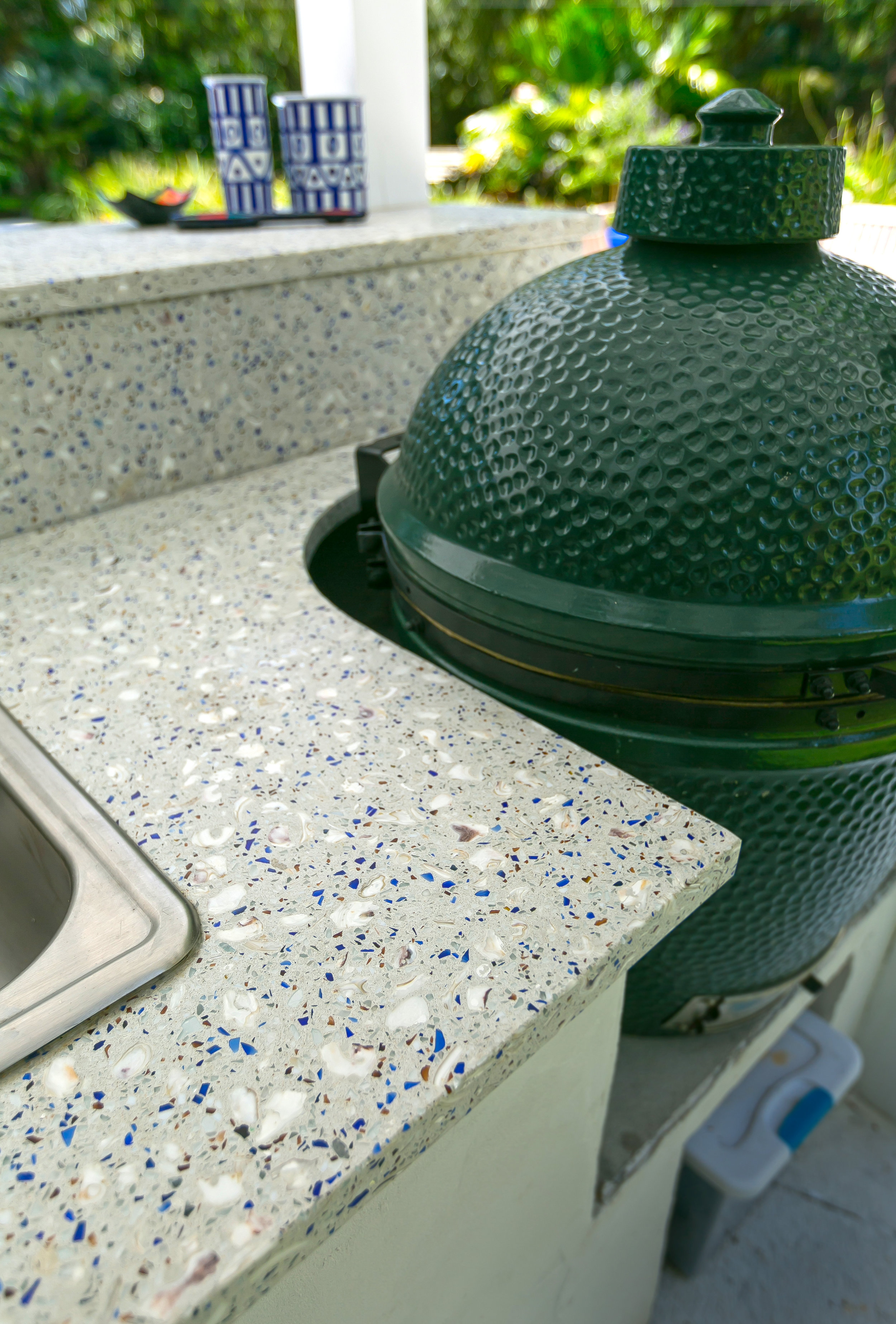 Love your Big Green Egg? Showcase it in your outdoor kitchen design with a custom GlassEco countertop, crafted with concrete for outdoor durability.