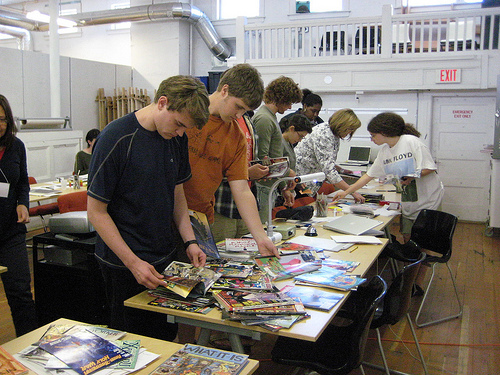 Students select various materials for their zine project.
