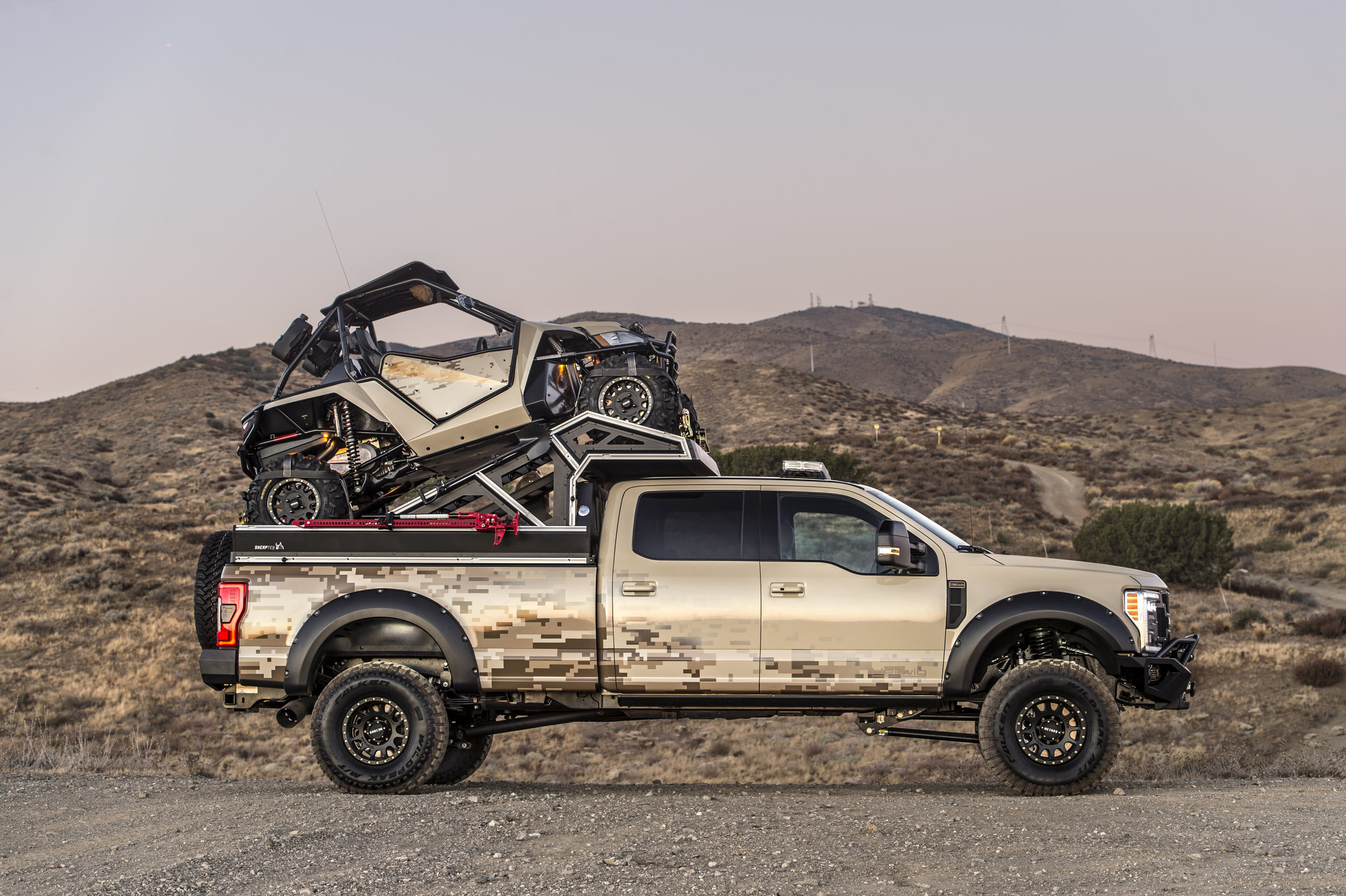 Toy hauler as accessory to modular truck bed replacement system with upper deck perfect for rooftop tents, canopies and more.