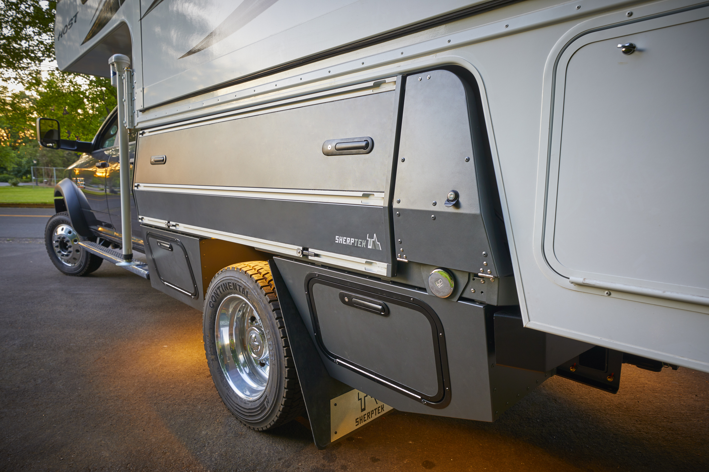 Ram 4500 chassis cab plus HOST Mammoth truck camper with SherpTek truck bed replacement system.