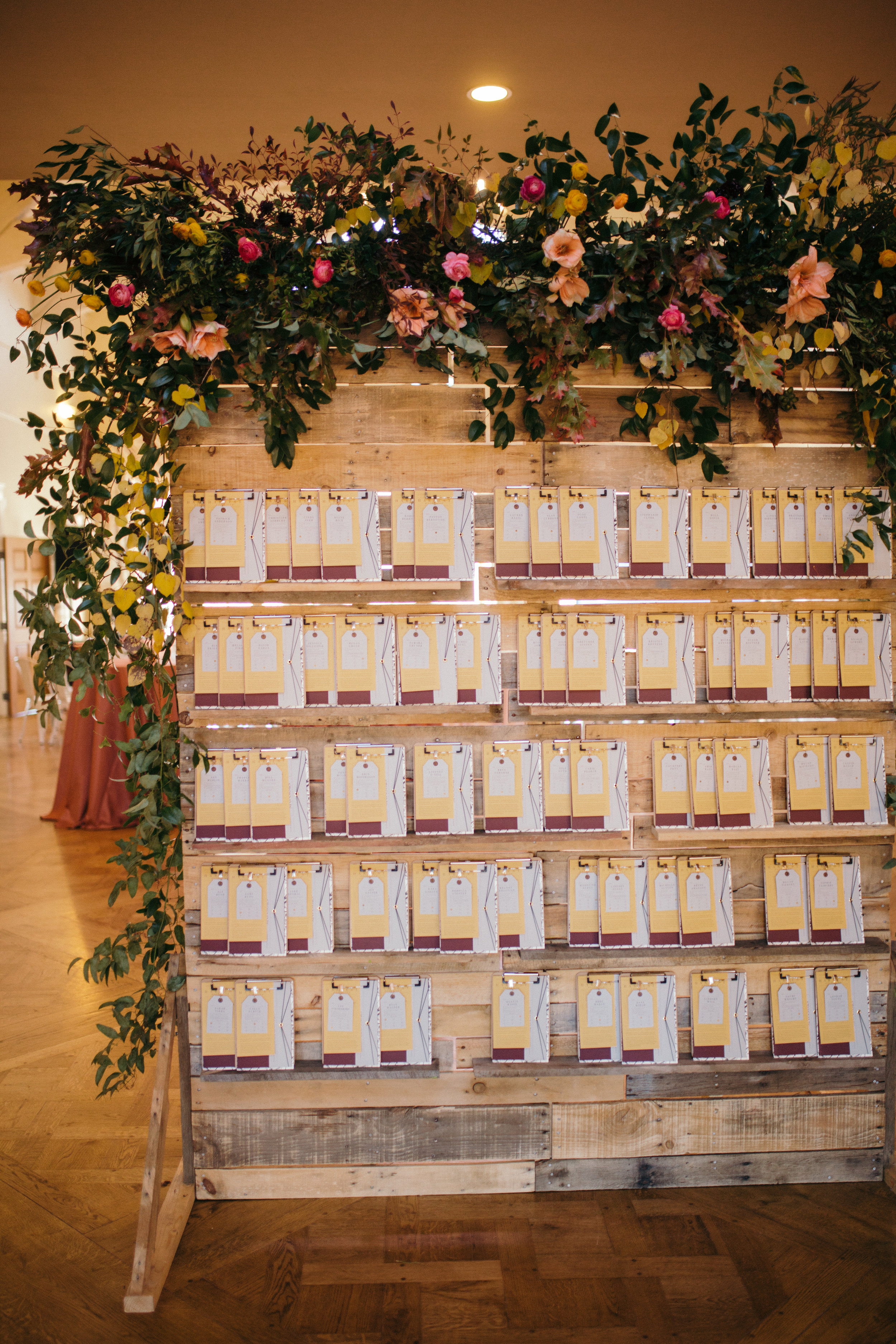This gorgeous palette wall by Tangerine Room Events was perfect for our clipboard escort cards.