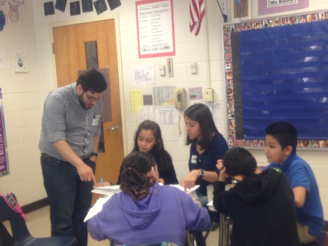 MSA volunteers assisting students at Clemmons Middle School during a visit.