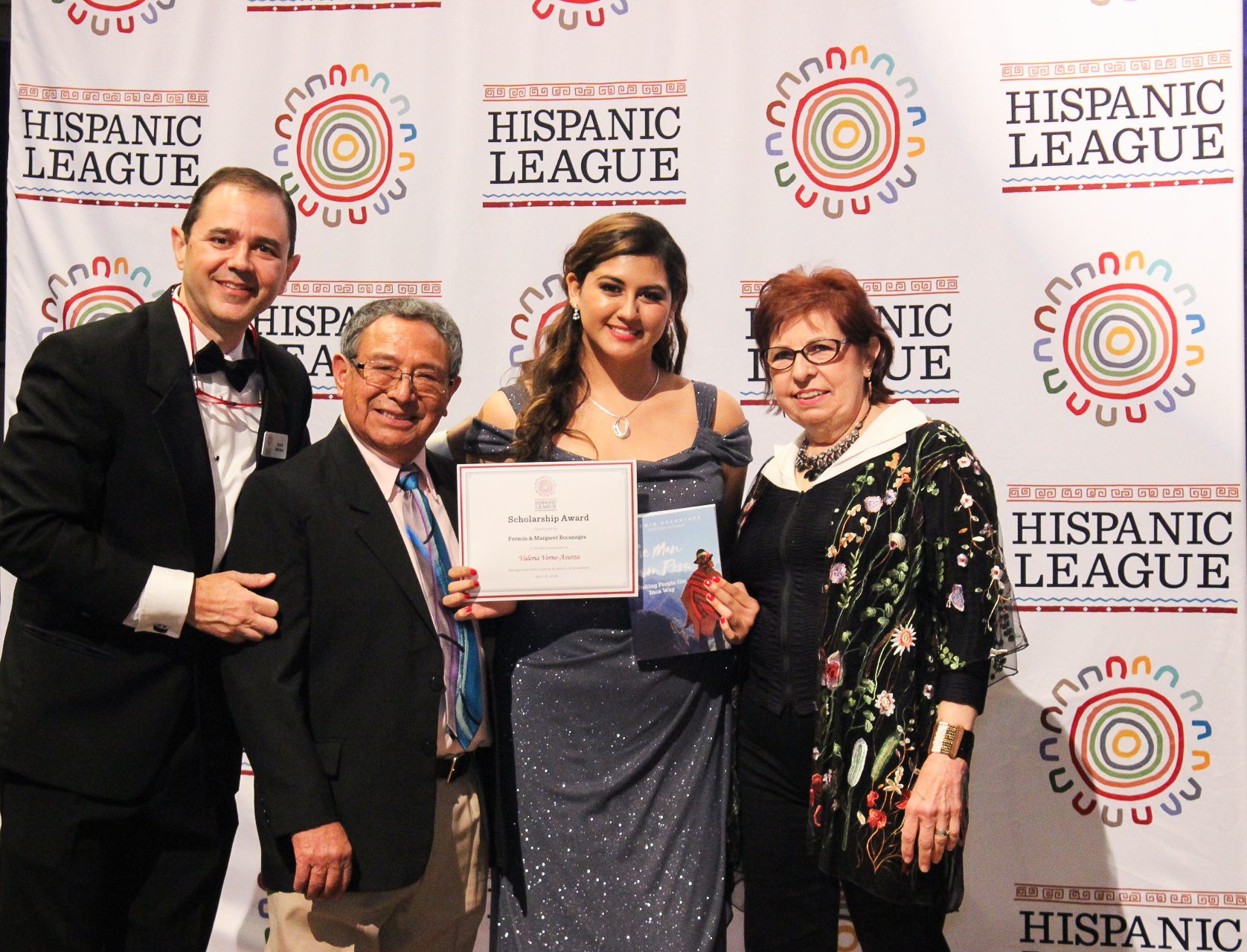 Scholarship recipient Valeria Verne, receiving her scholarship certificate from Fermin and Margaret Bocanegra at the Spanish Nite Gala.