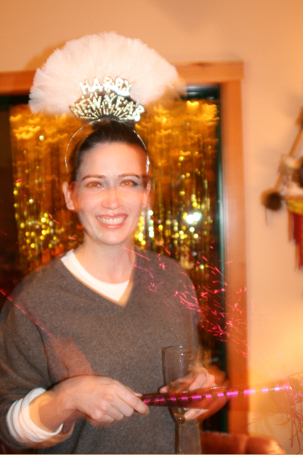 Tania celebrates the start of 2010 with a Vegas-style headpiece… tres chic…