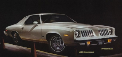 The name of the  1973 Pontiac Grand Am says it all: a cross between a luxury grand prix and a sporty Trans am. It was probably the most beautifully espressive American car of a decade not known for beauty and expression. (Pontiac advert Circa 1974)